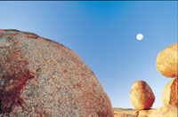 The Devils Marbles on the Stuart Highway also known as The Explorers Way from Darwin to Alice Springs - NT Tourism.